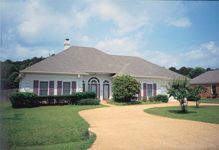 Attractive Hipped Roofed Ranch With Decorative Quoins | Plan 021D-0001
