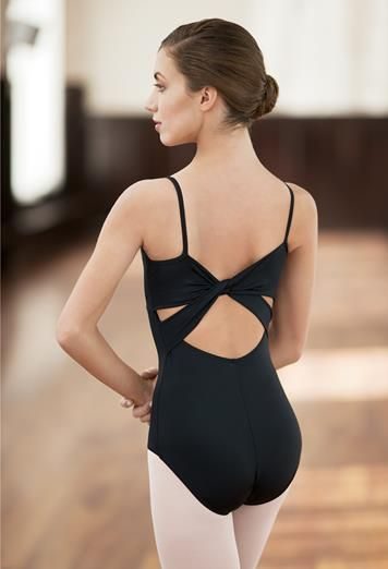 A basic with a twist! Two wide straps twist across the low scoop back of this camisole leotard. #black #leotard #backinblack