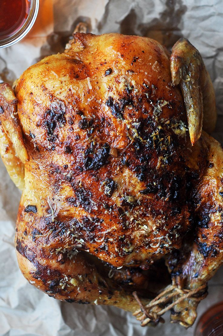 Whole roasted chicken in garlic butter with a cheesy parmesan crust.