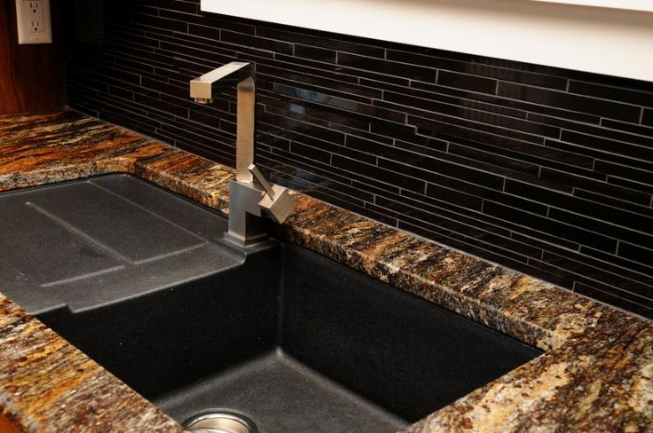 Under-mount black sink with Leather granite counter top