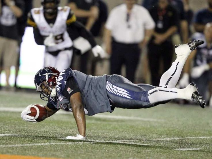 WK4 July 15 2016 - Ham.31 - Mtl.7 - Alouettes receiver Nik Lewis dives for extra yards after making a catch against the Hamilton Tiger-Cats during Canadian Football League game in Montreal, Friday, July 15, 2016.