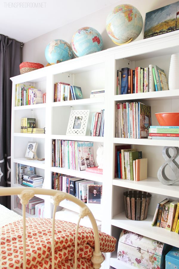 A cozy guest room makeover with an easy home library created with three freestanding bookcases!