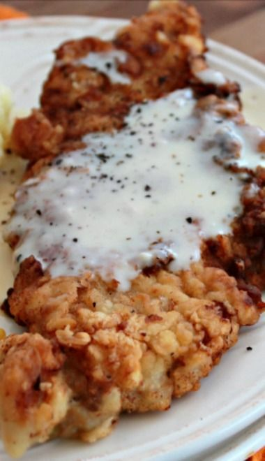 Country Fried Pork Chops with White Gravy _ It's served up with a basic white gravy that goes perfectly with it.