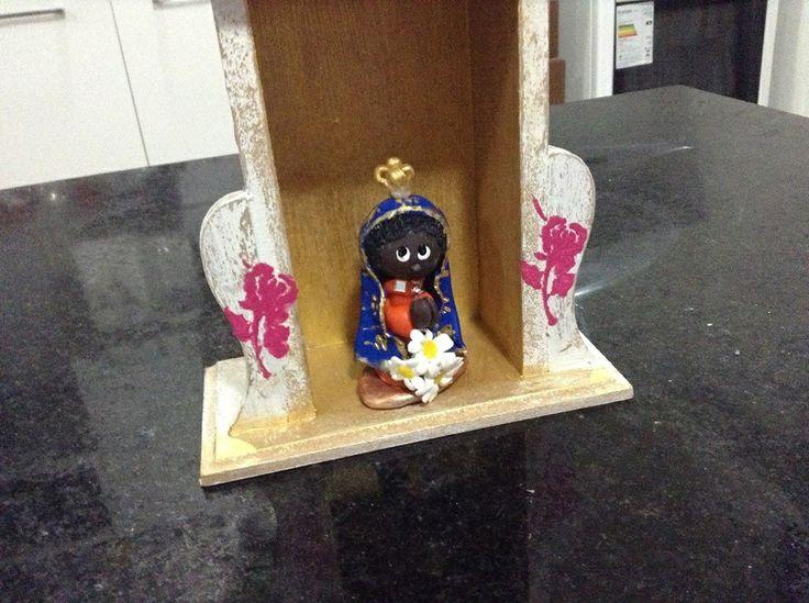 Nossa Senhora Aparecida feita com porcelana fria ( biscuit)