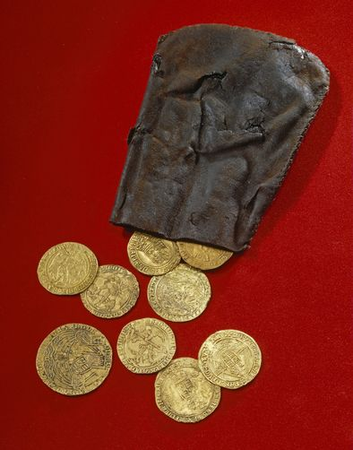 Gold coins recovered from the wreck of the Mary Rose, which sank in 1545. A single coin was roughly a day's wages for the vice admiral, or more than a month's pay for an ordinary seaman.