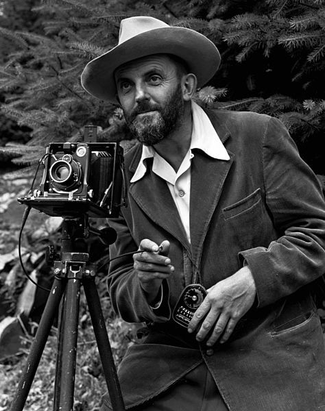 Ansel Adams and camera, 1950, public domain via Wikimedia Commons.