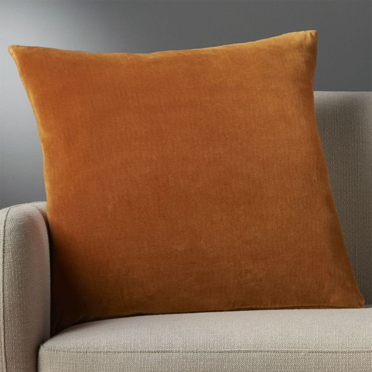 """Shop leisure copper 23"""" pillow.   Soft and cozy in velvety cotton, copper XL square flips to natural cotton canvas.  Do the math: CB2 low prices include a pillow insert in your choice of plush feather-down or lofty down-alternative (a rare thing indeed)."""