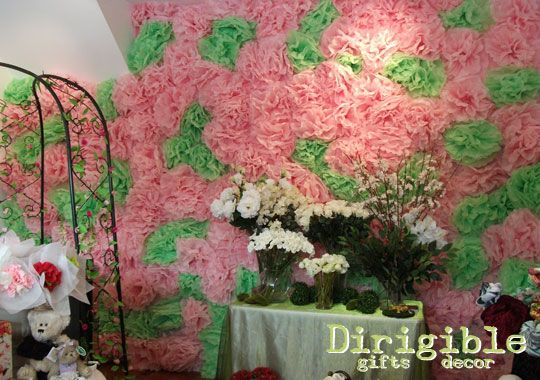 A pink and green pom pom wall was a spectacular way to add colour and drama to the rear shop wall.
