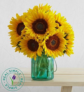 Let the sunshine in with a brilliant sunflower bouquet in a sweet teal-glass mason jar, for a touch of country chic.