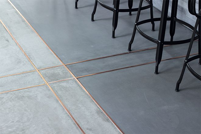 Concrete style. Tiles. Brass trim. Kitchen floor