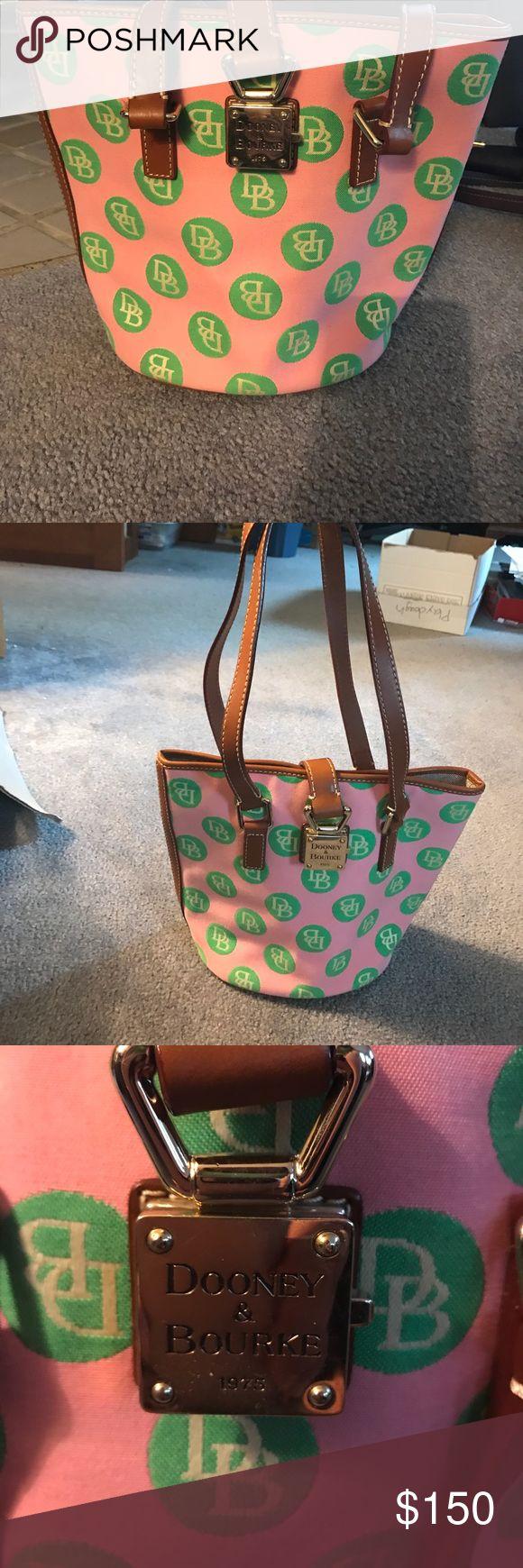 Dooney & Bourke pink and green polka dot handbag Great condition! Barely used! Bucket sized Dooney & Bourke handbag. It is pink with green polka dots with DB inside. Dooney & Bourke Bags Shoulder Bags