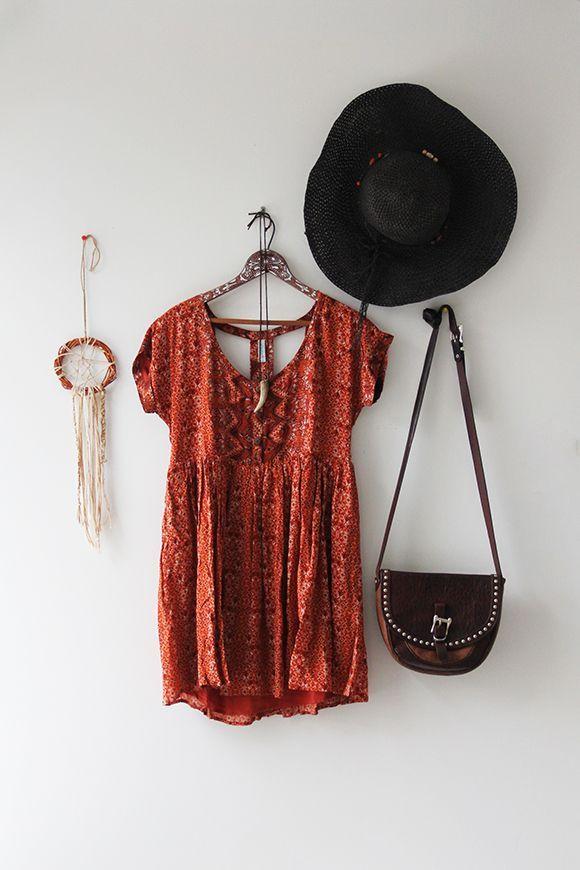 orange printed babydoll dress with boho crochet detail , cross body bag , big floppy hat