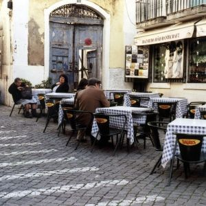 Sidewalk Cafe in downtown Lisbon. by ursula