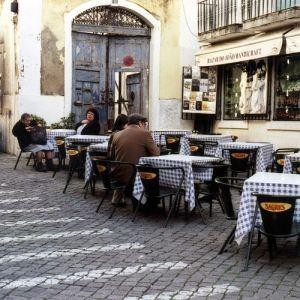 Sidewalk Cafe in downtown Lisbon. by ursula