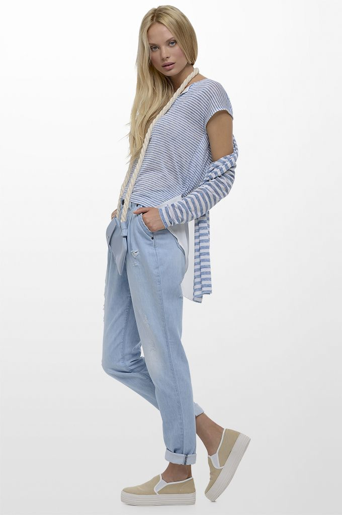 Sarah Lawrence - long cardigan with combination of two fabrics, short sleeve asymmetrical blouse with combination of two fabrics, bleached denim pant with pleats.