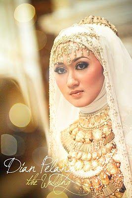 Indonesian Bride & Fashionista Dian Pelangi.  Watch a video on her blog.