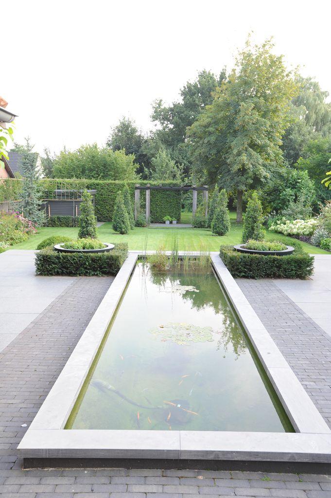 www.hendrikshoveniers.nl Strakke vijver - Moderne vijver - Exclusieve vijver - Vijver onderhoud - Zichtlijnen tuin - Taxus blokken - Bestrating - Natuursteen
