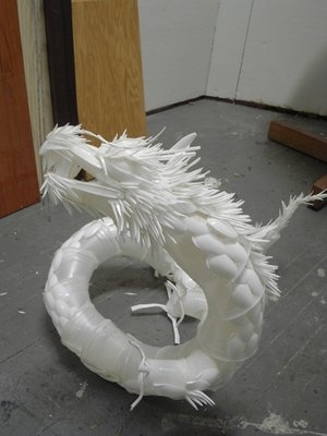 Dragon  Sculpture from plastic cups, spoons, forks.