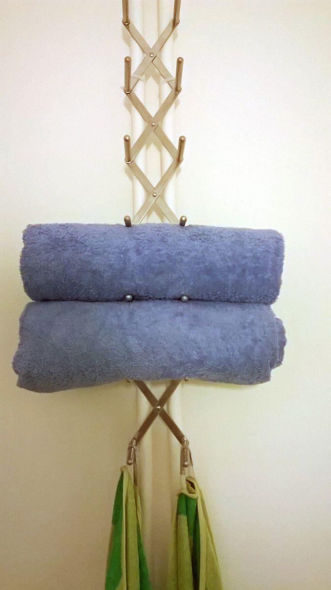 """Variera pot lid organizer as a """"shelfless"""" towel holder."""