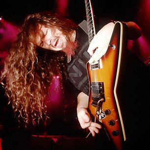 """Dimebag Darrell - One of modern metal's key figures, Dimebag Darrell founded Pantera with his brother, drummer Vinnie Paul Abbott–forging a style that combined brutally precise, punk-honed grooves with splatter-paint melodic runs. Tragically shot by a deranged fan during show w/his band Damageplan in 2004–on the anniversary of John Lennon's death, freakishly enough –tribute: """"One of the greatest musicians to grace our world,"""" Black Sabbath's Geezer Butler said simply. """"Rest in peace."""""""