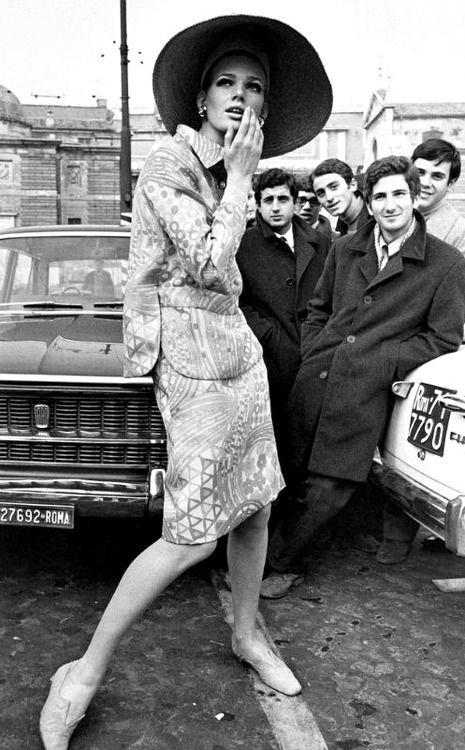Model with adoring male fans in Rome - 1967