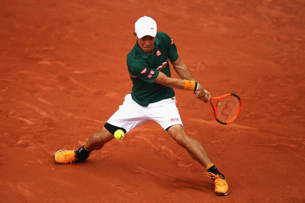 Kei Nishikori of Japan plays a backhand during the mens singles third round match against Hyeon Chung of Korea on day eight of the 2017 French Open at Roland Garros on June 4, 2017 in Paris, France. 2017 French Open - Day Eight