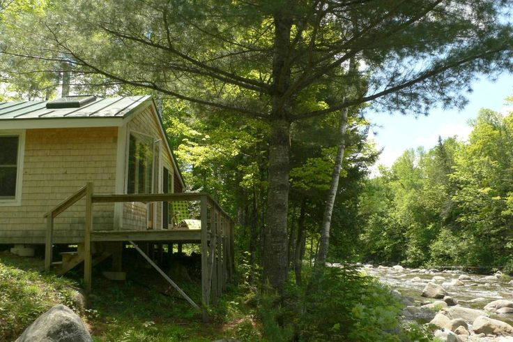 Entire home/apt in Phillips, US. Unplug at this cosy off-grid cabin in the High Peaks region of Western Maine, home to 10 of Maine's 14 mountains over 4000 ft.    This recently renovated camp surrounded by conservation land features living room/kitchen with wood stove,  bedroom w...