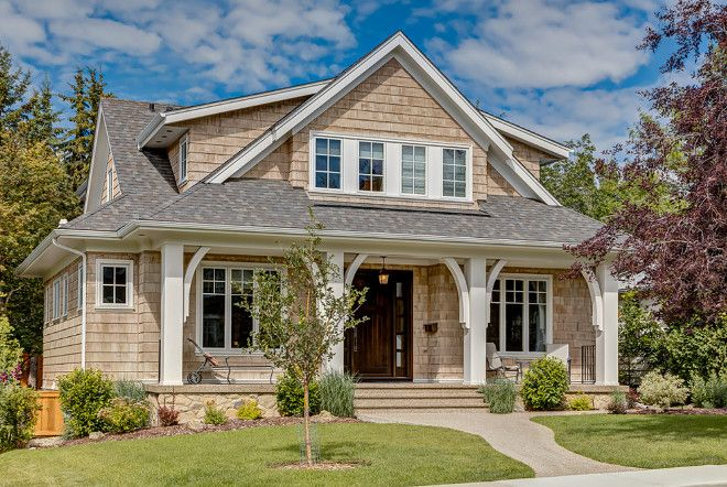 Porch Columns with Brackets. Craftsman style shingle home with Brackets and trim on Porch Columns. Manor House Crafted Homes Inc