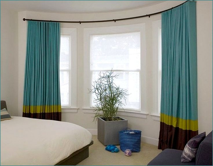 Bow bay or gradual curved windows can be hard to dress. Here is a great simple look that combines the functionality of a bay pole with the very eye catching stylishly made curtains.