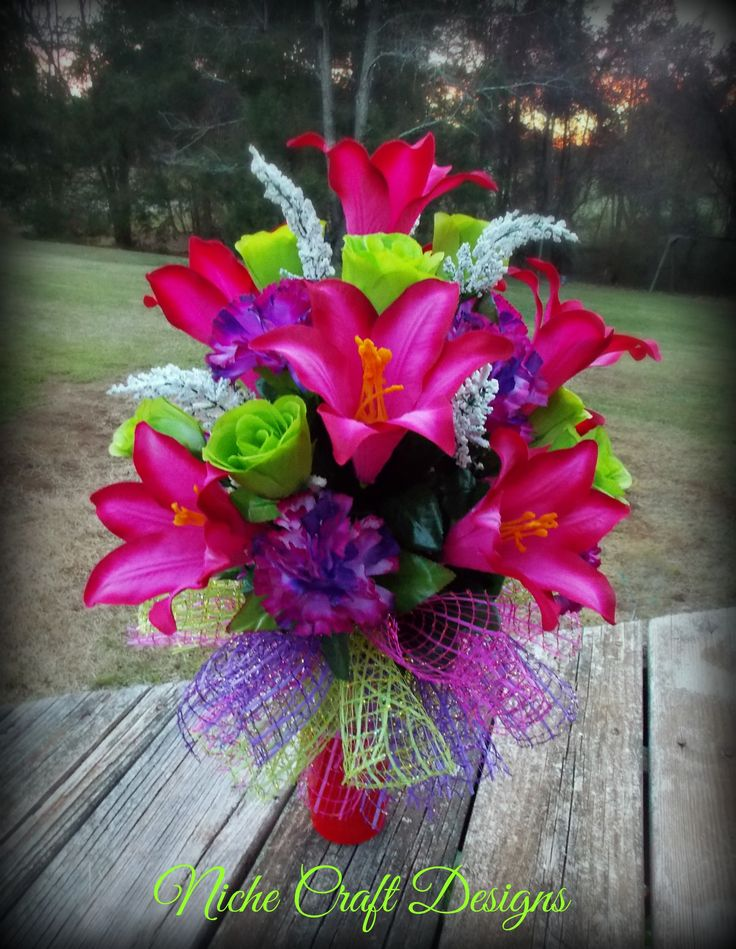 Spring flowers arrangement for a cemetery vase.