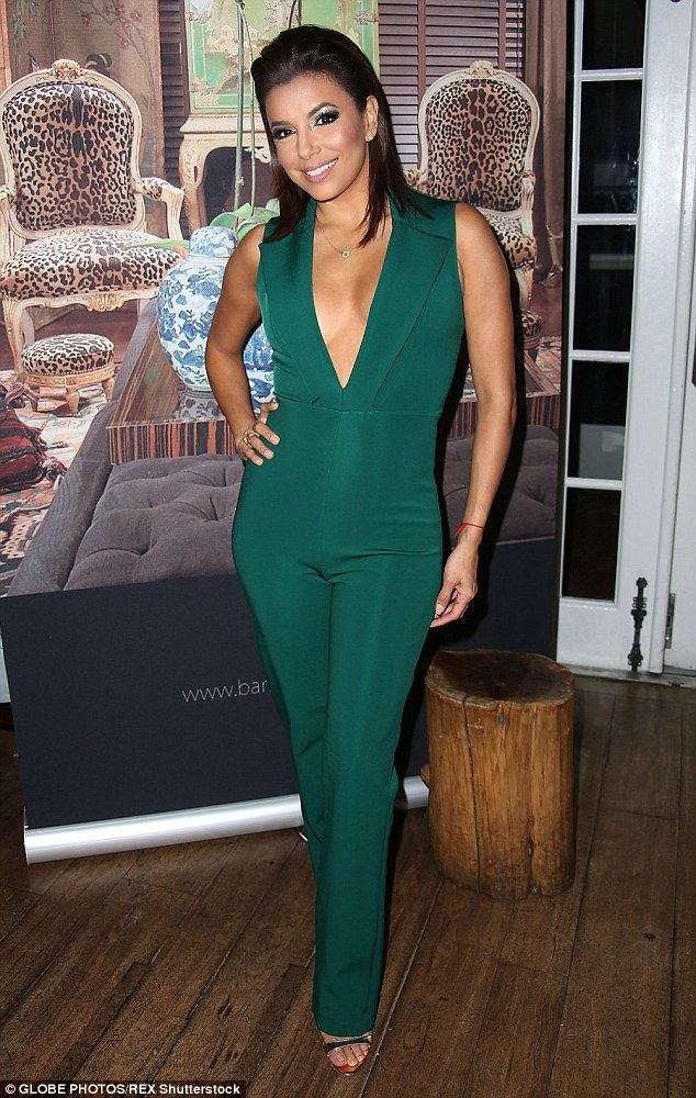 Green with envy: Eva Longoria flashed a glimpse of her ample cleavage in a plunging emerald-coloured jumpsuit as she attended a book launch in Miami, Florida, on Thursday evening