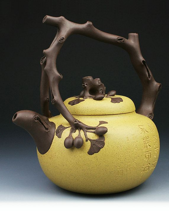 Brown and yellow clay carved ceramic YiXing teapot | Art Pottery Mall | 8 days of Christmas Giveaway