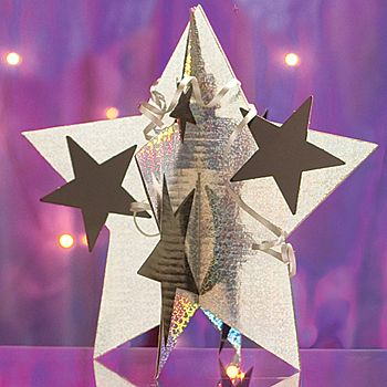 This Holographic Silver 3D Star Centerpiece features a holographic star, black stars and black curling ribbon to use as accents. Each set contains 6 stars.