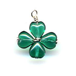 How to make a 4-leaf clover with heart beads, from http://www.favecrafts.com/Decorating-Ideas/Four-Leaf-Clover-Charm#