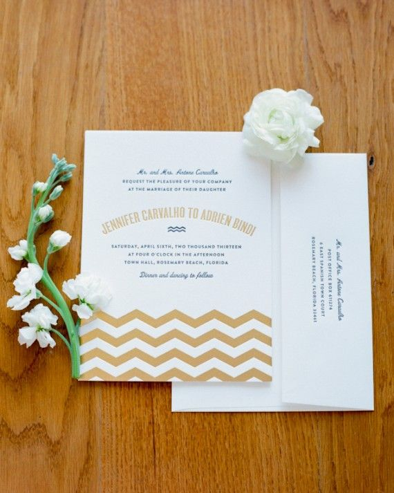 """New York-based stationer Bella Figura designed this letterpress invite, which introduced this Florida wedding's black, white, and gold palette. """"The gold foil chevron pattern indicated that our wedding was to be an elegant fête at a seaside destination, but didn't read 'beachy,' which was important to me,"""" the bride says."""