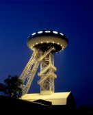 Germany, Luenen, Ruhr area, North Rhine-Westphalia, Research and Development Centre LUENTEC, IBA project Emscher region, Luigi Colani design, pit tower, office constructed on a pit tower, form of an Ufo, at night