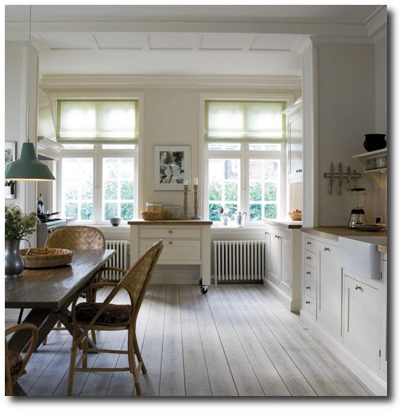 Warm Whites- Walls -Slipper Satin, Cabinets, -Pointing (No. 2003), with the skirting boards painted in Lime White all from Farrow & Ball