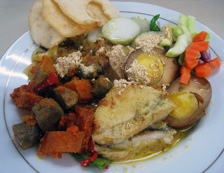 Lontong Cap Go Meh is a peranakan Chinese Indonesian take on traditional Indonesian dishes, more precisely Javanese cuisine. It is lontong served with rich opor ayam, sayur lodeh, sambal goreng ati (beef liver in sambal), acar, telur pindang (hard boiled marble egg), koya powder (mixture of soy and dried shrimp powder), sambal, and kerupuk udang (prawn crackers).