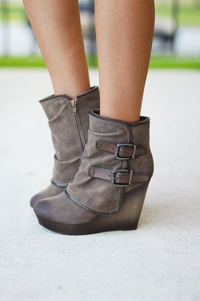 OMG! Your favorite wedge booties are now available in Taupe! We are going crazy for these NEW Gemini Taupe Wedge Booties! The zipper lining, wrapped heel and buckle details give them an edgy look that