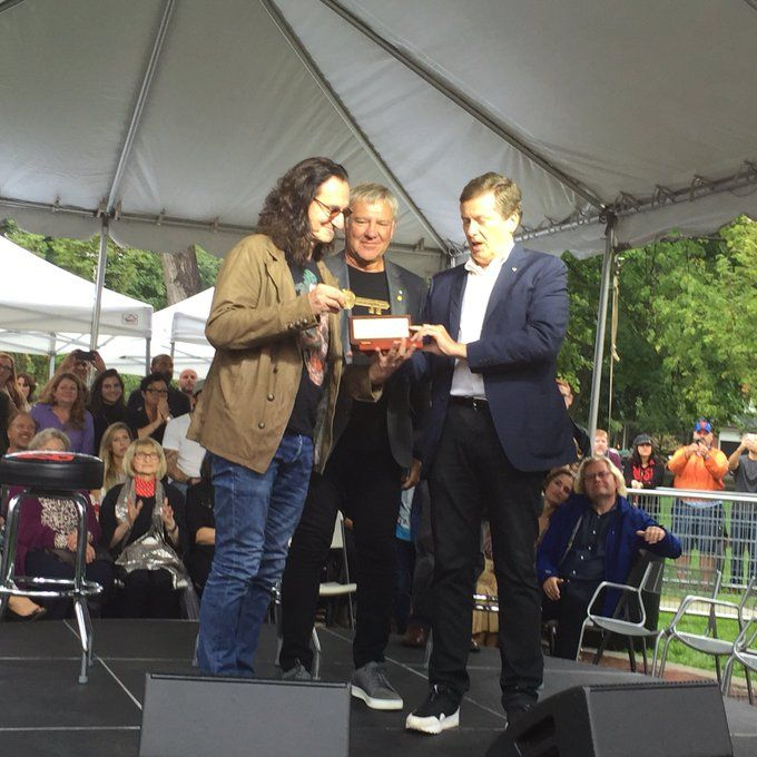 Rush's Alex Lifeson and Geddy Lee receiving the key to Toronto from Mayor John Torry.