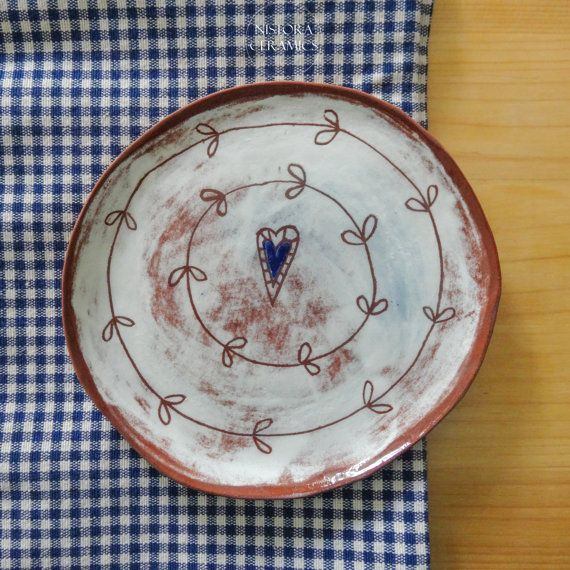 Terracotta dish with sgraffito decoration on white and blue underglaze
