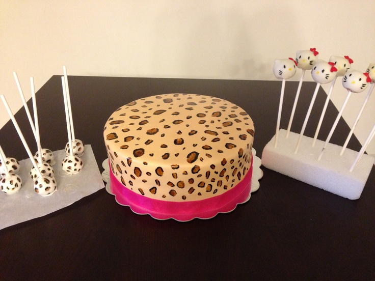 Cheetah print cake with cheetah print cake pops and hello kitty cake pops. Made by me . :)