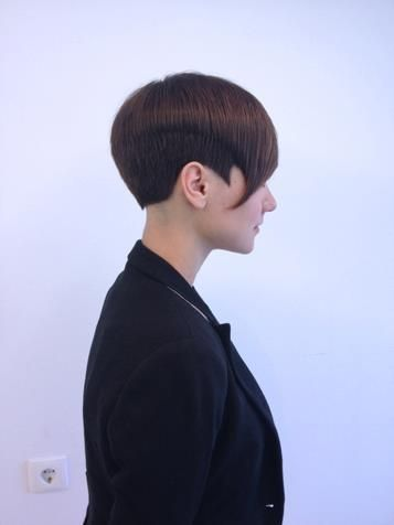 zenhair:    A feminine short style, the hair at the sides and back has been undercut, and the top left longer (we call the topdisconnected from the underneath). A beautiful outline has been created, especially the pointed sideburn and curve of the fringe which exaggerates the feminine head shape and bone structure.  Hair by Ivan Jagarcec, Zgat academy.