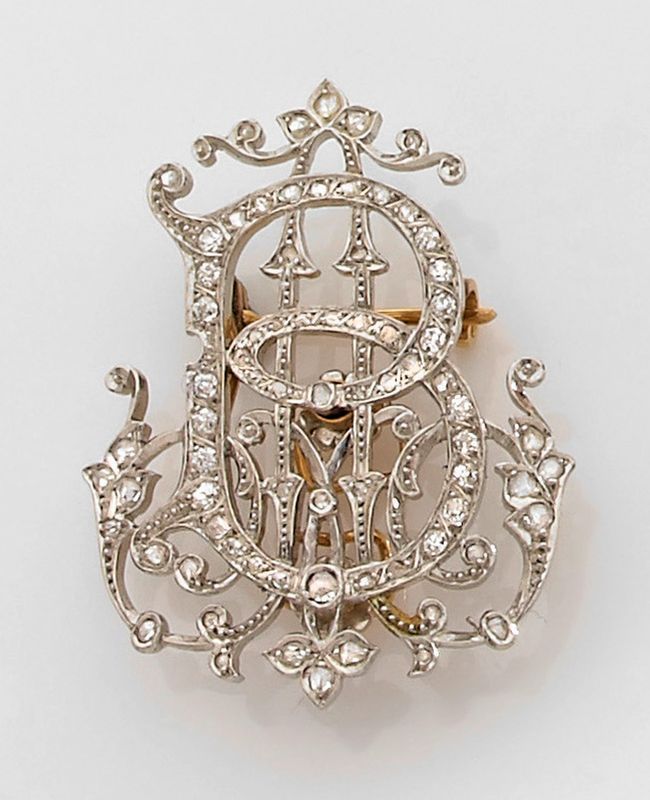 A 1900 diamond, platinum and gold monogram brooch.  ~b~