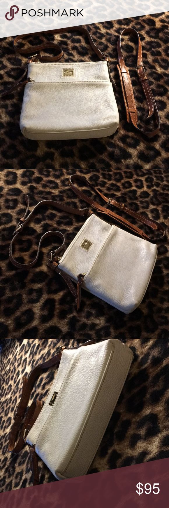 """EUC Dooney & Bourke Convertible shoulder/Crossbody This beautiful Dooney & Bourke Bag is in Excellent Condition! Only used a few times! Can wear as a shoulder bag or add additional strap and wear as a Crossbody Bag! Lots of storage for a small bag! One outside zipper pocket, one main pocket with a zipper pocket, two separate pockets & Key Holder!  Clean inside & out! Like new!  Smoke free home!  L 9"""" H 8.5"""" W 1.5"""" Dooney & Bourke Bags"""