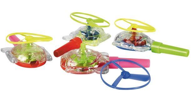 Origineel om uit te delen. Blaas door de staart van de helikopter en de propellers vliegen de lucht in! Afmeting: 7,5 x 4 x 2,5 cm