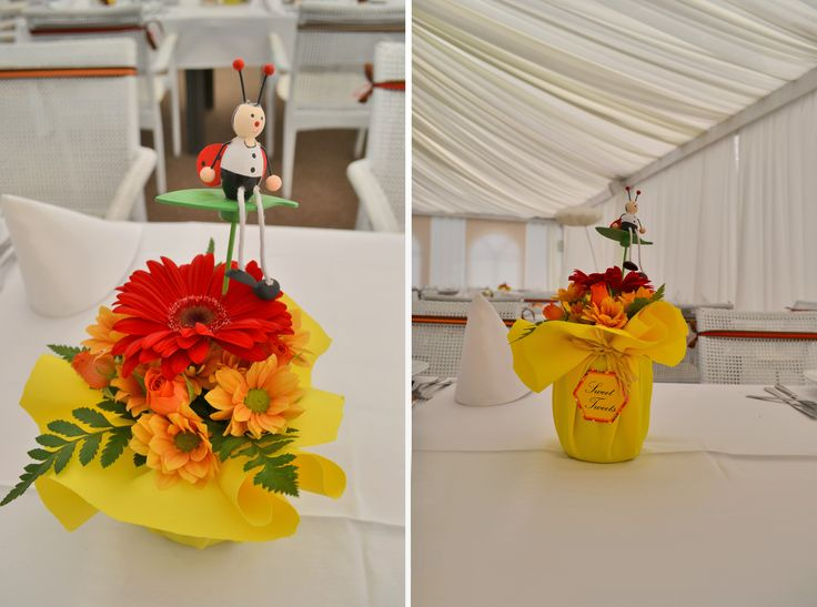 "we had a baptism party with the ""Winny the Pooh "" theme.these are the flower arrangements we did.Turned out great,the parents were really happy about the final result."