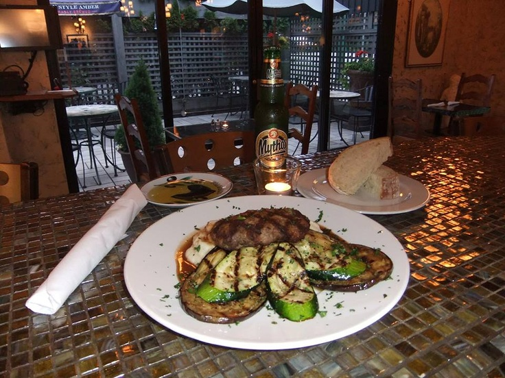 Greek Sheppard Pie - Mashed potatoes, sliced eggplant & zucchini & a freshly ground beef/lamb patty, seasoned with house spice. Served with freshly baked bread & olive oil/balsamic vinegar for dipping. $14.50  Bottles of Mythos Greek Beer - $7.00