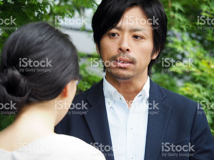 Two People Are Talking, Man With A Puzzled Look