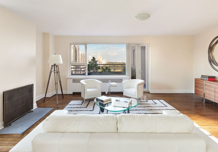 An iconic view of Central Park makes the best decoration for this living room.